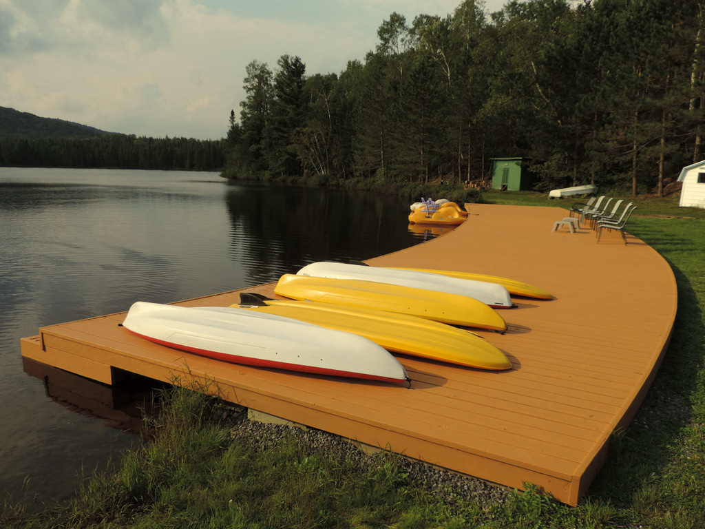 canoe and kayak on lakeside dock