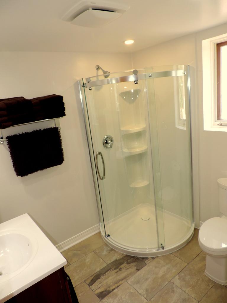 Glass shower in basement bathroom
